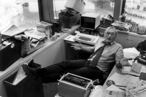 Journalist Mike Royko, lounging at his desk