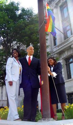 Booker raises Pride flag